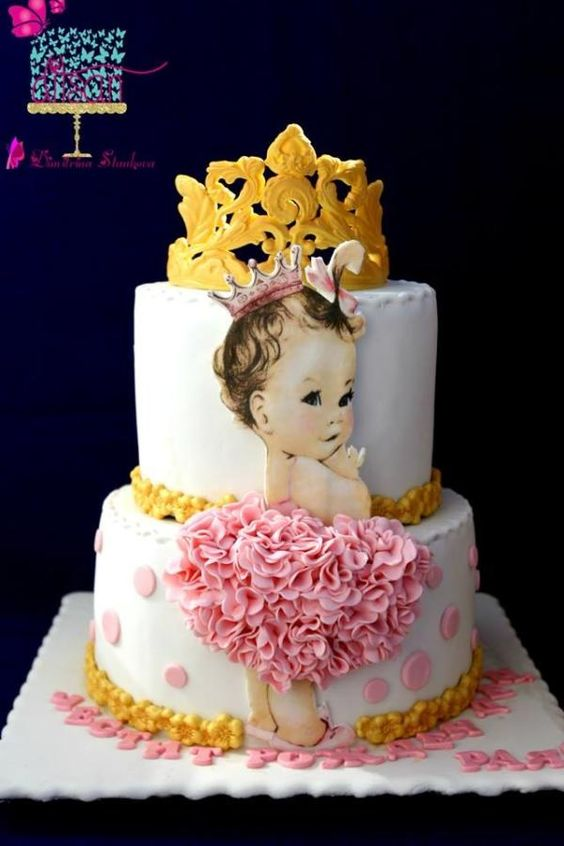 a fondant figurine with ruffles made on sugar and an edible crown