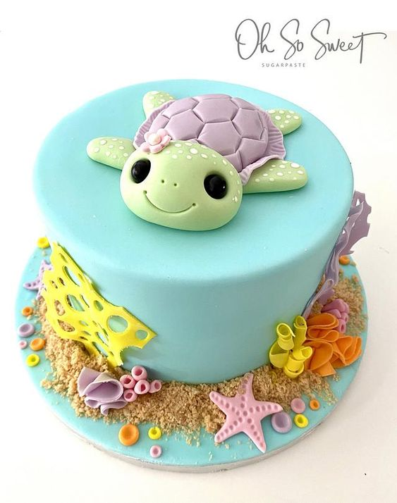 a sugar turtle cake with blue fondant covered and aqua effect