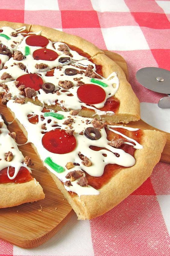 a slice of realistic looking fondant pizza