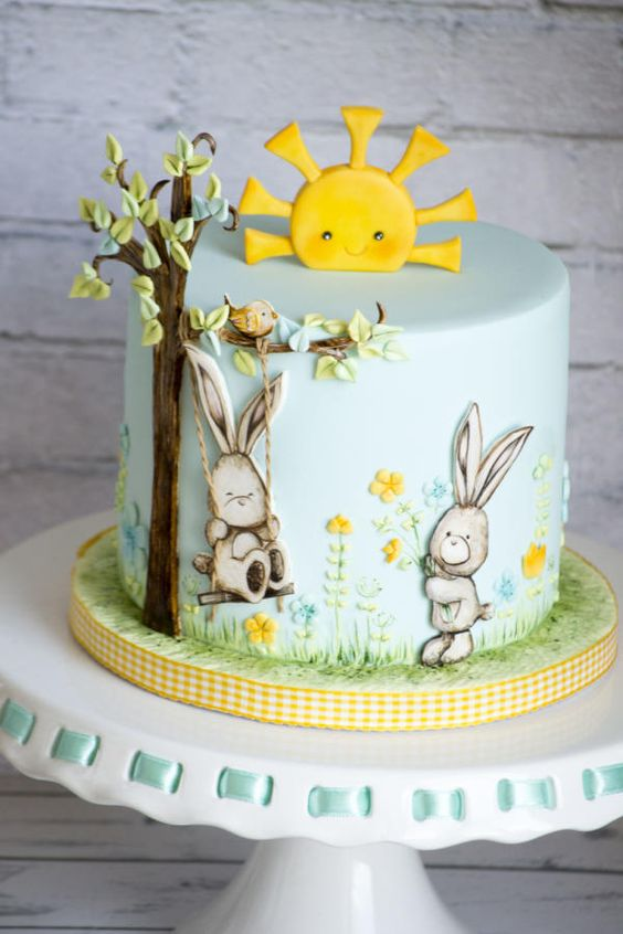 blue fondant cake with sugar bunnies and a yellow fondant sun for Easter Cake Tutorials