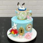 Alice in Wonderland Cake Tutorials with a cup on it and the mousse on the cake made of sugar