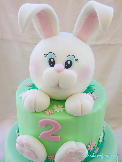 a 3D effect fondant bunny on a green fondant layered cake - Easter Cake Tutorials