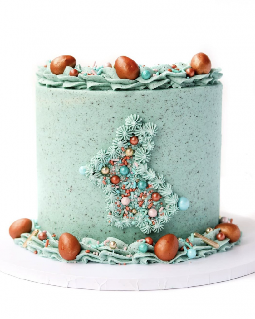 blue frosted cak with little eggs on it made of chocolate eggs