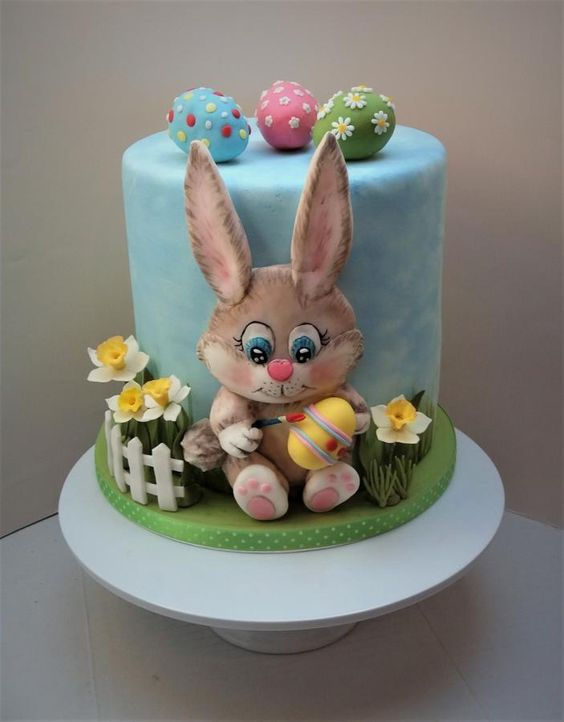 a fondant made 3D bunny with Easter eggs on the cake