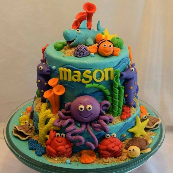 octopus made of sugar and other edible elements on blue colored fondant