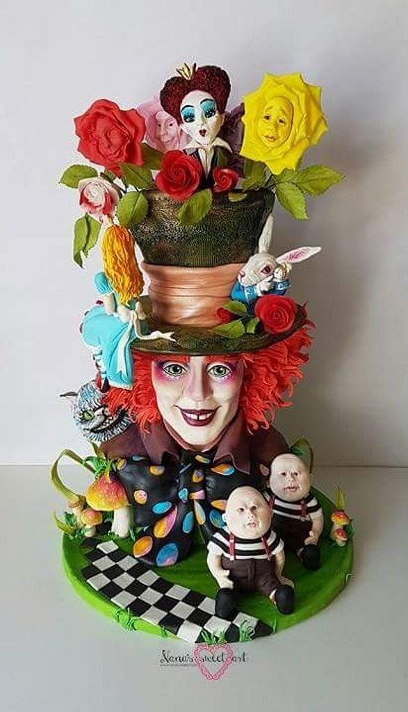 mad hatter theme cake with hatter and other characters from the movie on the cake