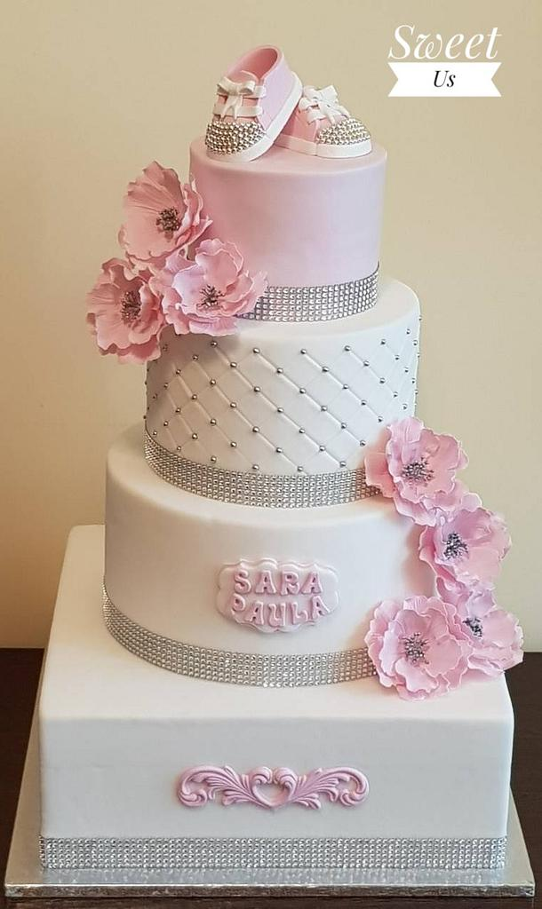 four tier Christening cake tutorials with fondant booties and flowers