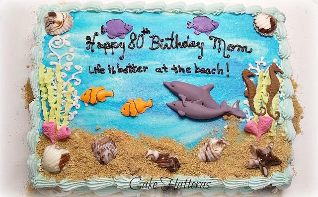 an aqua theme with fondant fishes and shells