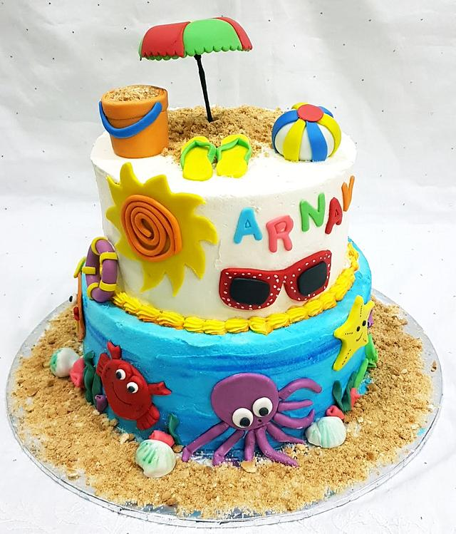 Beach Party Cake Tutorials - fondant yellow slippers, umbrella, bucket and ball and sea creatures made of sugar on the cake