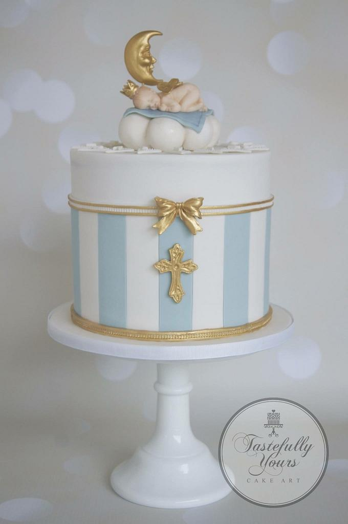 Christening cake tutorials - blue and white theme cake with golden work on it with a moon and child on it