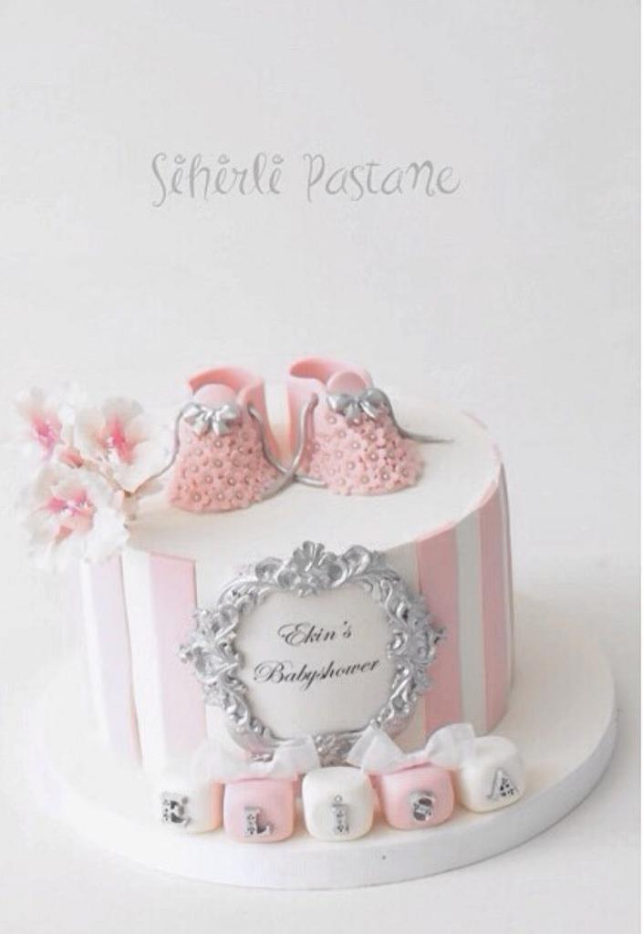pink and white fondant baptism theme with sugar booties and edible silver work