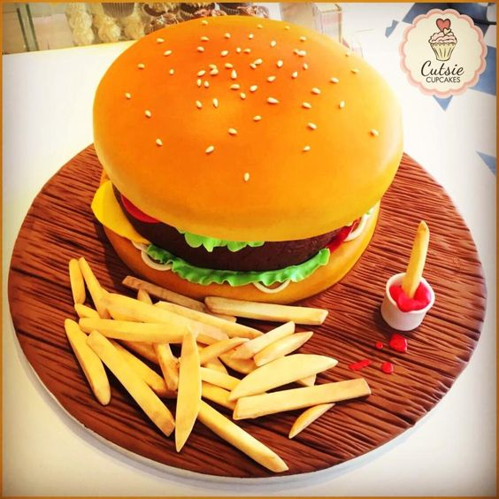 burger cake with french fries and sauce on a wooden cake board - These Burger Cake Tutorials will teach you how to make a realistic burger cake from scratch. The Perfect birthday cake for burger lovers or junk food lovers
