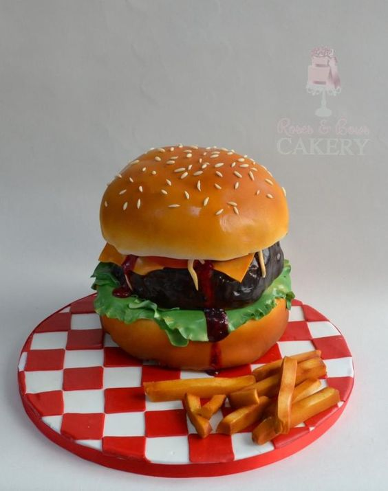 red and white chequered cake board with a fondant hamburger cakes