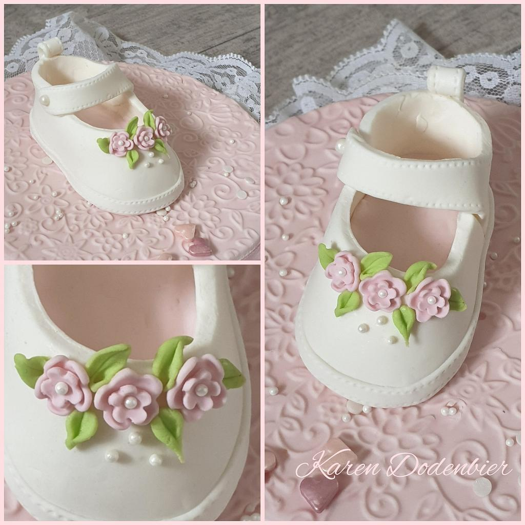 simple white fondant shoes on a cake