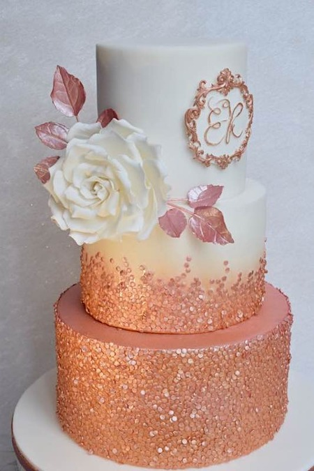 bronze cake with sequins work on it with white gumpaste flower