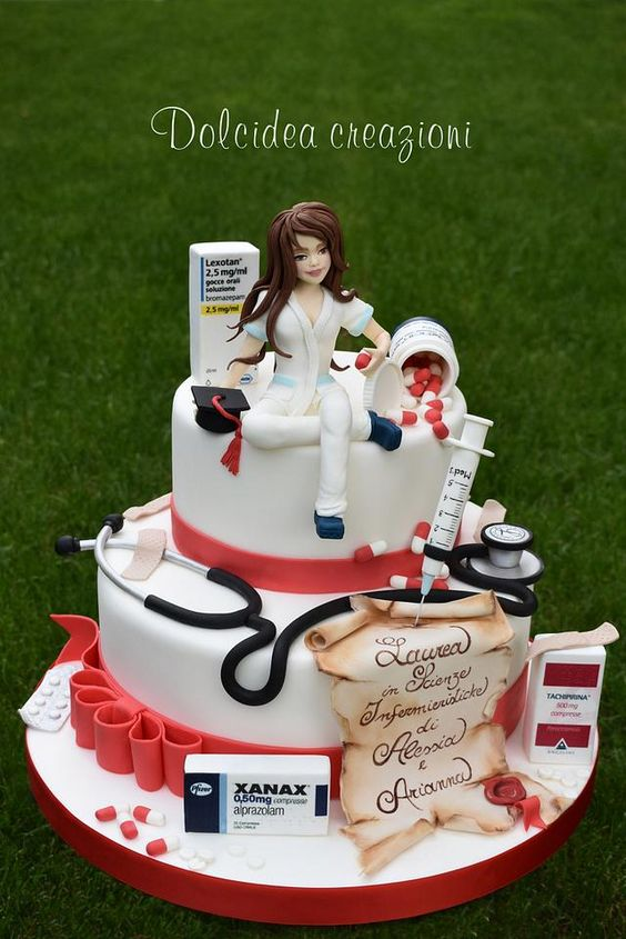 two tier cakes with red and white theme and female health care worker figurine on it