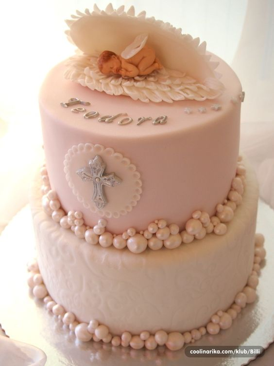 a baby in a fondant shell and sugar pearls all around