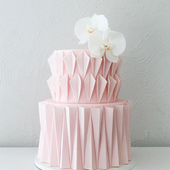 pink theme colored ganache with white orchid sugar roses on a two tier cakesponge