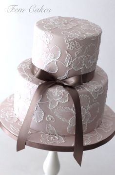 Brush Embroidery Cake Tutorials - royal icing flowers on a brown cake with brown ribbon