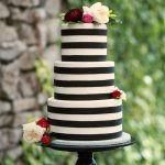 black and white cakes with fresh roses on it
