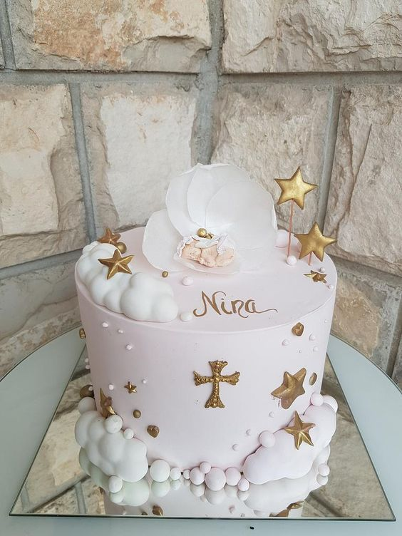 a white and pink cake with gold stars - Christening cakes for girls