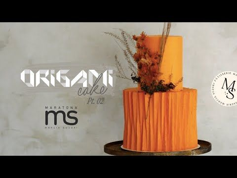 orange theme colored ganache with textures on it and flowers