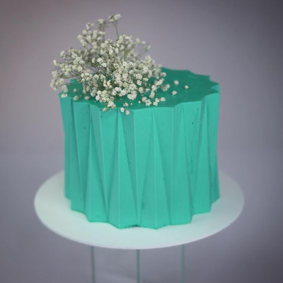 green colored ganache and white flowers