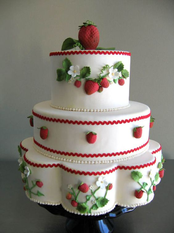 a fondant three tier cake with strawberries made of fondant