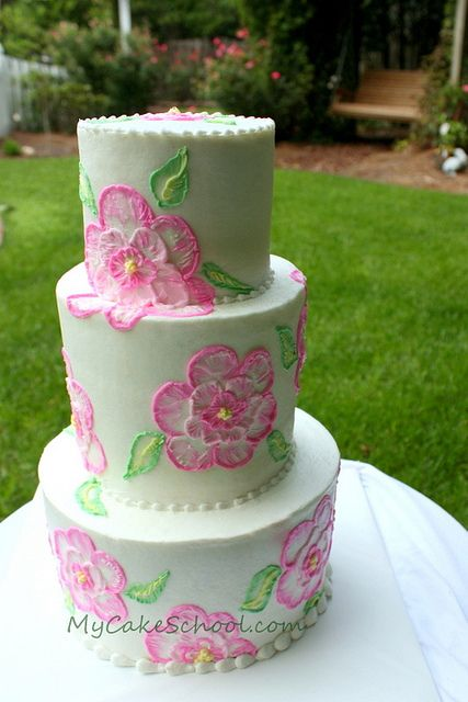 3 tier cakes painted with royal icing flowers