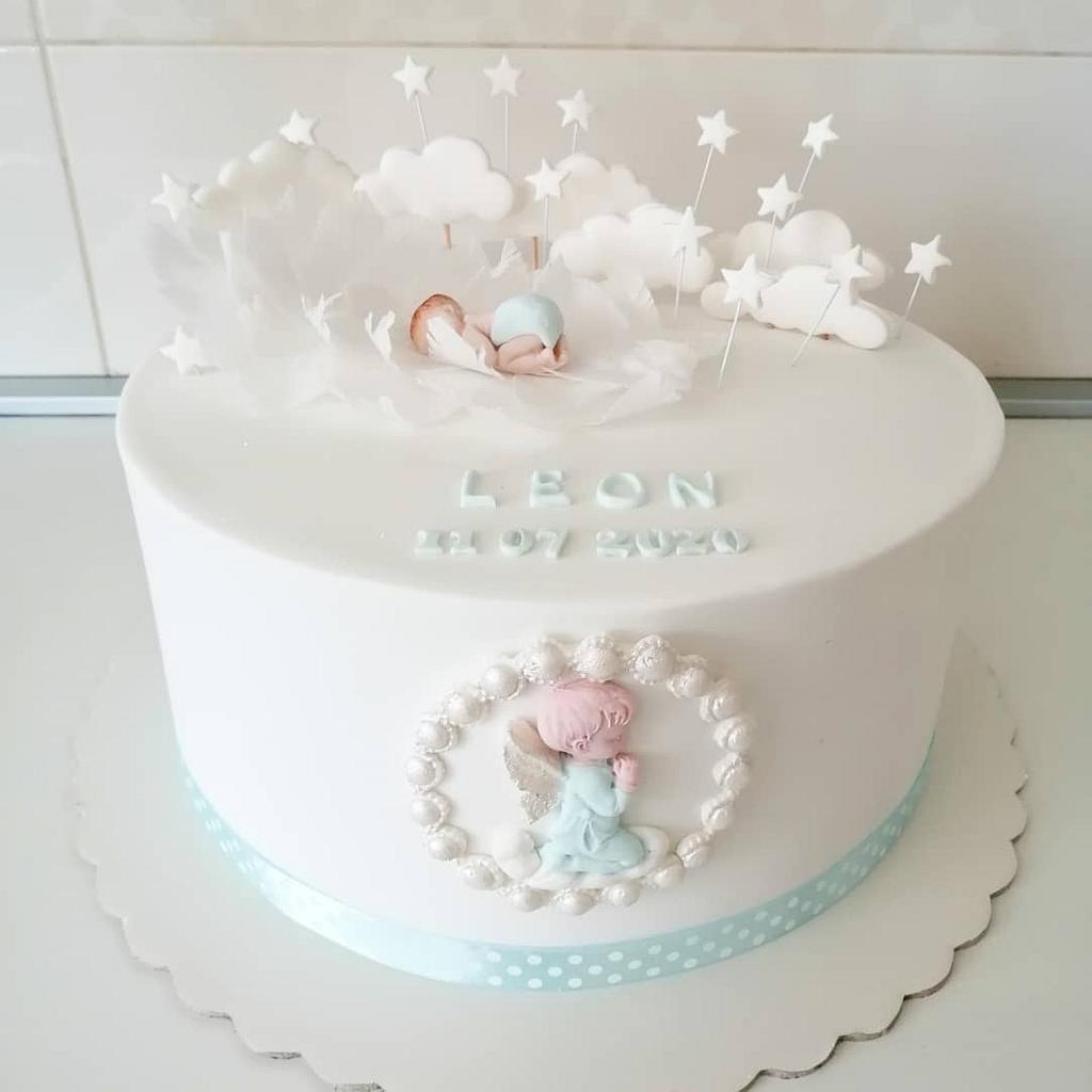 a blue and white cake with sugar clouds and sugar cut angel - Christening cakes for girls