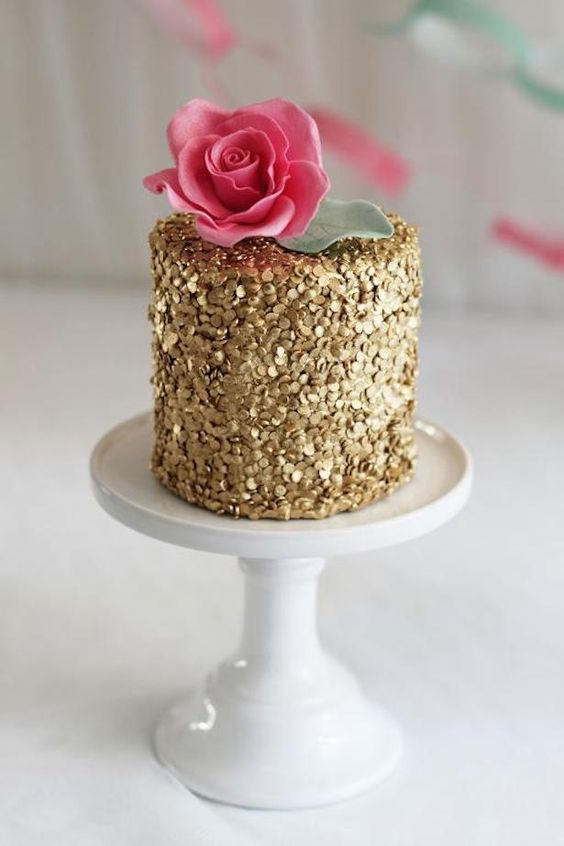 sequins work on a cake with pink sugar flower and sugar leaf