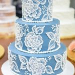 blue and white cakes with icing work on it