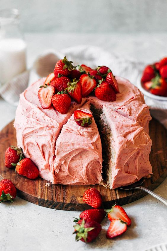 a creamy cake made with buttercream and topped with strawberries