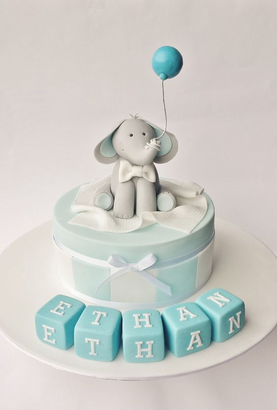 Christening cake for boys with elephant made of sugar with a balloon