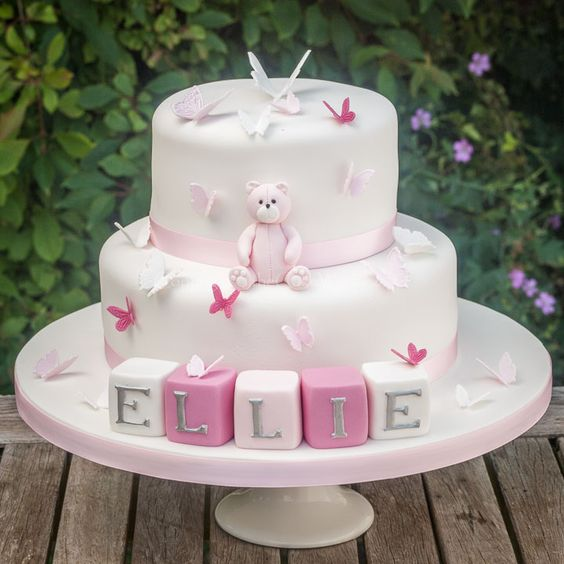 sugar teddy made with pink fondant and sugar cut butterflies - Christening cakes for girls