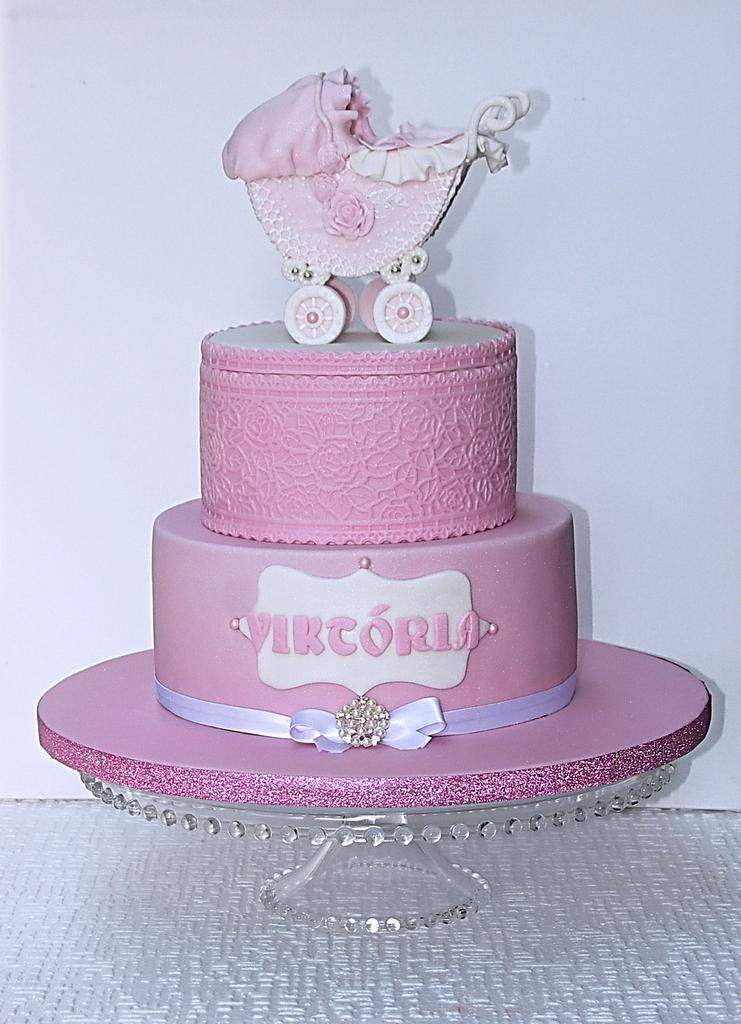 pink sugar cradle on a pink and white frosted fondant beauty