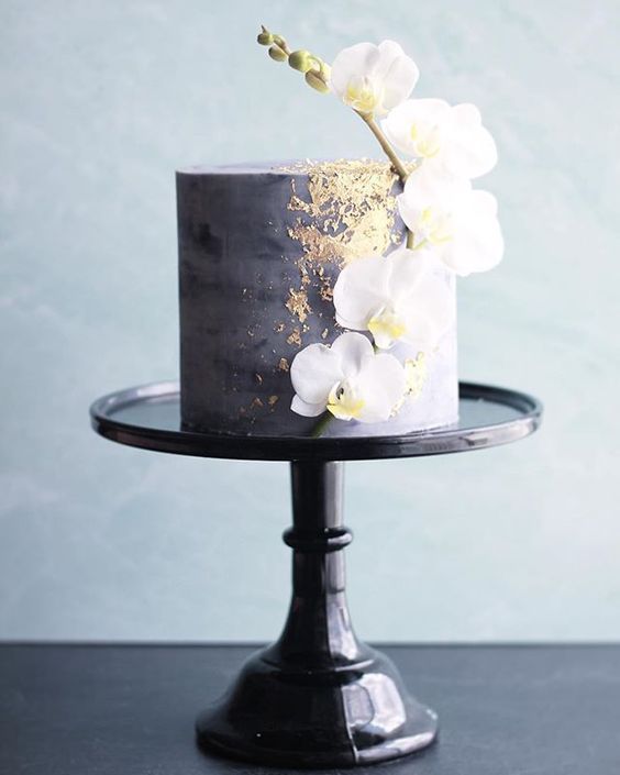 a simple grey cake on a black cake table