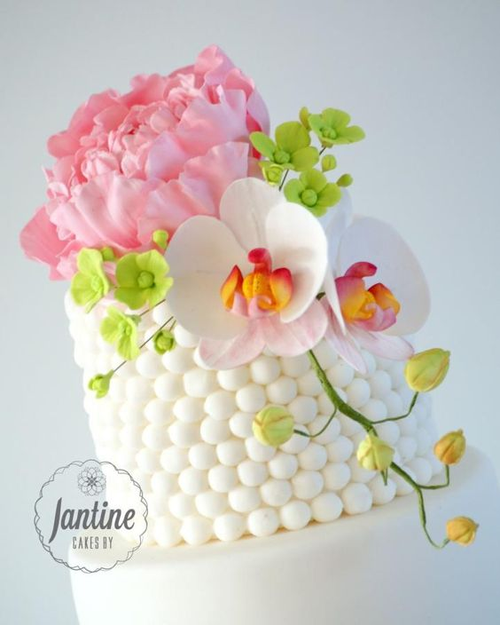Moth Orchid Tutorials - colorful flowers on a cake made of gumpaste