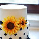 polka dots black cake with handmade flowers on it