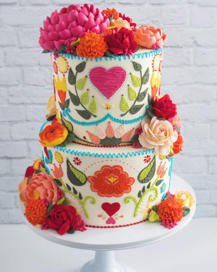two tier embroidery cake with buttercream flowers