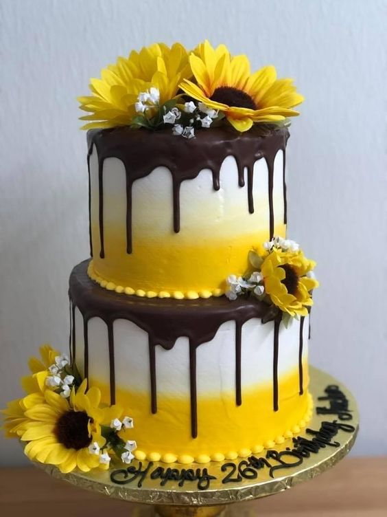 fresh flowers on a two tier drip effect cake