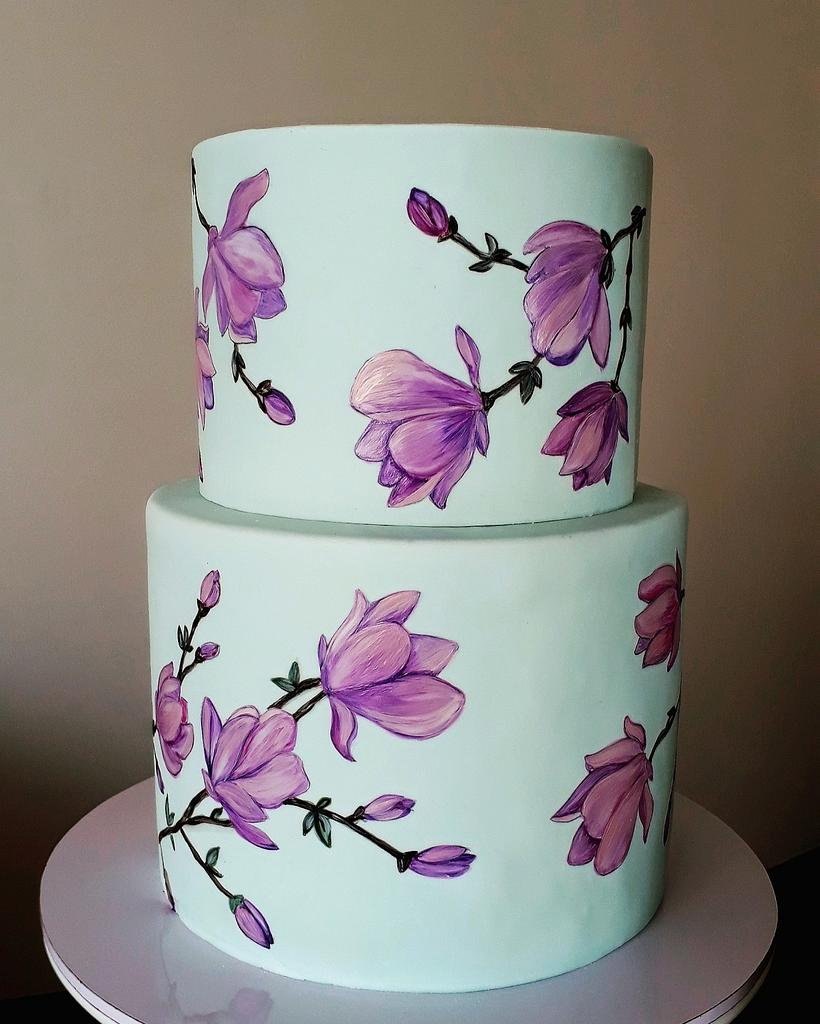 two tier cake with orchids painted on it