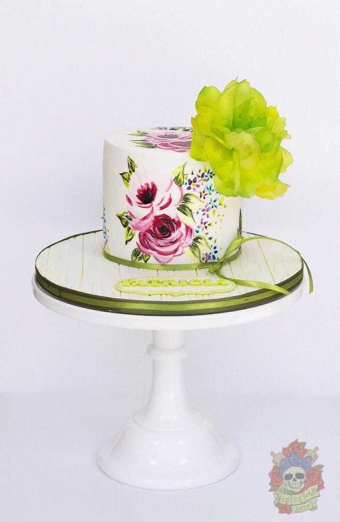 painting on cakes with green sugar flower