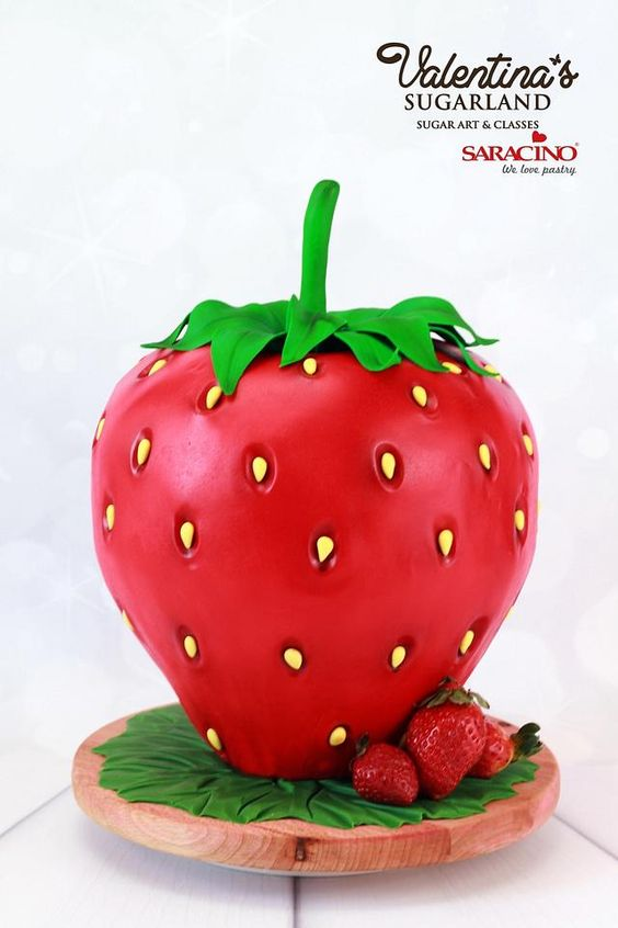 strawberry theme cake that is gravity defying