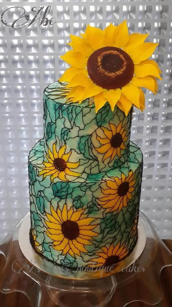 glass painting on cake with sunflowers in yelow and green