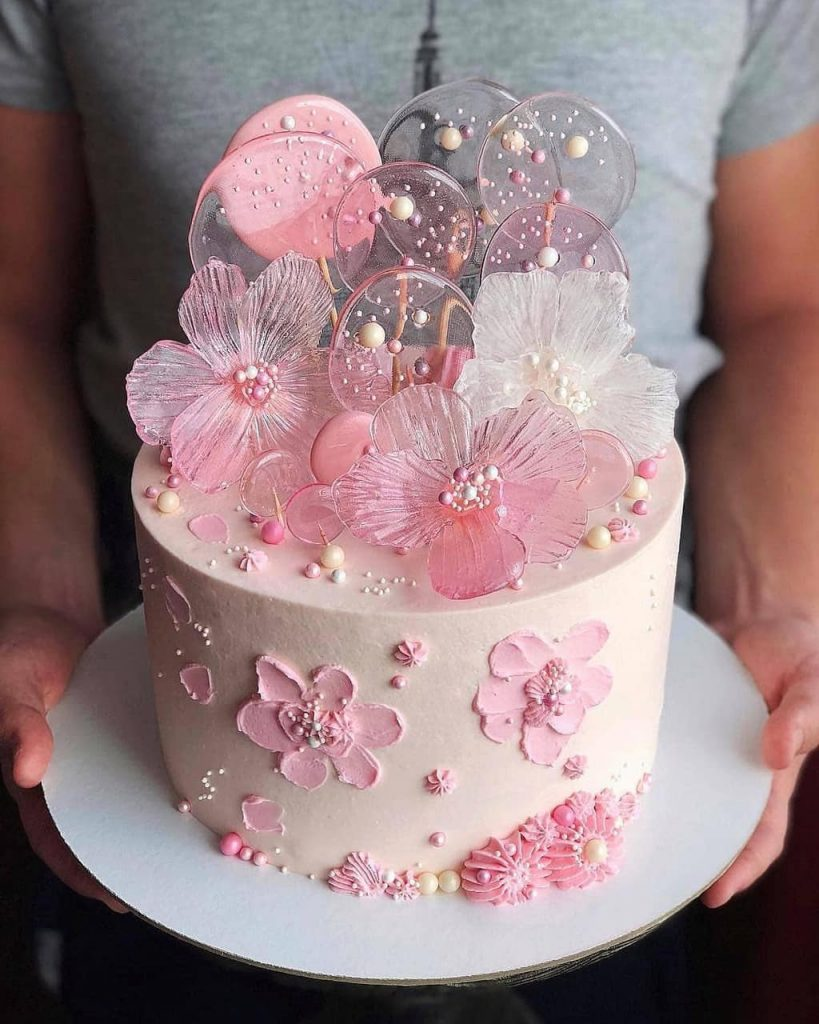 flowers and lollipops made of isomalt sugar in pink