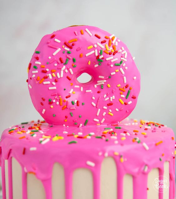 pink color frosting with sprinkles on it