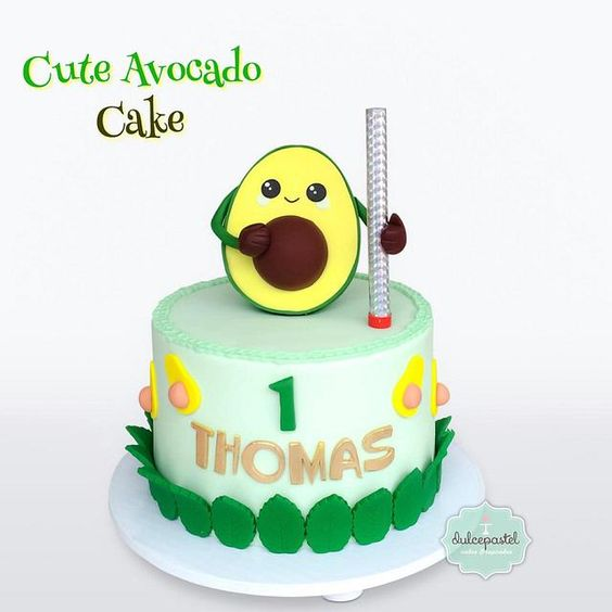 fondant with green leaves cake with a sugar topper in avocado shapr