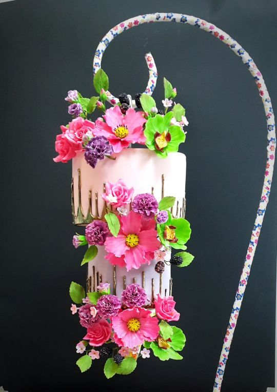 colorful cake with drip effect and gumpaste flowers - 4 BEST Chandelier Wedding Cakes Tutorials