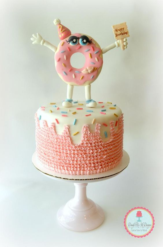 fun cake with pink icing and fondant work